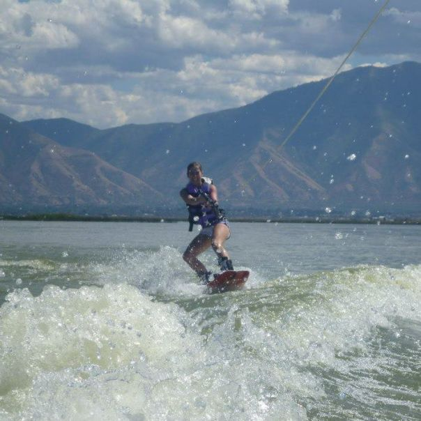 Wake boarding behind a boat
