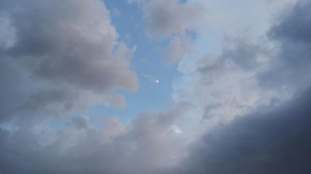 Just a random pic of the moon with the storm rolling in :)
