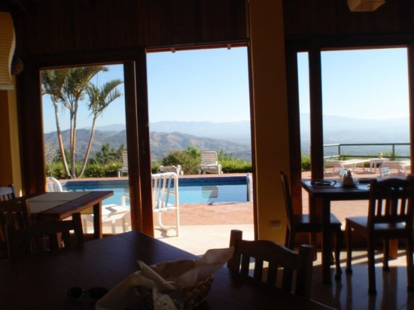 Looking from inside the restaurant to the pool out to the mountains